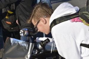 Student looking at Mercury through telescope
