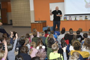 Author reading to students