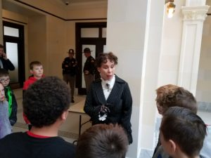 Students learning about women's suffrage at State Capitol