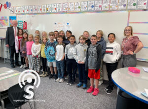Dr. Godfrey stands with Sarah Ricks' 4th grade class at Aspen Elementary School