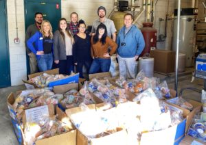 Picture of Telarus employees donating weekend food packs