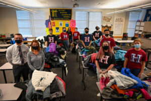 Students and staff stand with donated coats