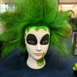 A mannequin with green hair