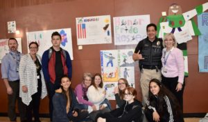 Picture of resource officer and students
