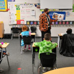 Principal Buddy Alger reading to students