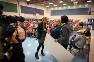 Teacher is presented a check