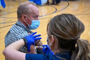 A nurse administers COVID-19 vaccine