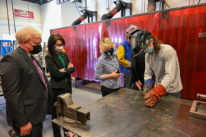 Lt. Governor Diedre Henderson gets a welding demonstration