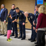A student shakes hands with cops.