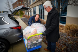 A Carmax employee unloads socks onto a cart.