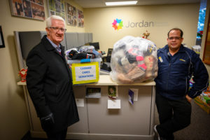 A Carmax employee delivers boxes of socks to the Foundation.