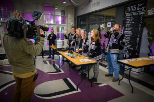 Riverton High School students cheer for the Fox 13 camera.