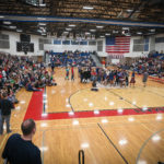 School gym packed with students.
