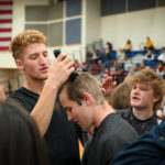 Students shaving their heads for charity.