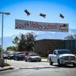 Cars Under South Valley School Banner