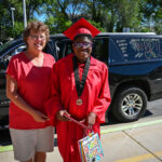 South Valley Graduate and Principal Rita Boullion Pose for a Photo
