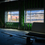 Two windows in Hidden Valley Middle School looking at the new Mountain Point Elementary.