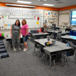 Two teachers in a classroom