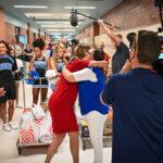 Robyn Luke receives a hug