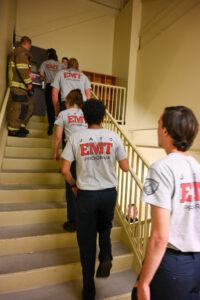 Students at JATC South climb a flight of stairs
