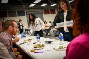 Herriman High School students pass out cookies to judges