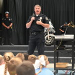 Riverton City Police Chief Don Hutson speaks to students.