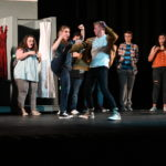 A pretend fight on stage between the male and female leads.