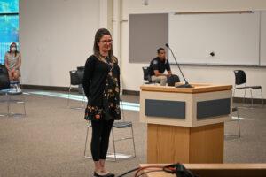 Heather Reich stands before the Jordan School Board