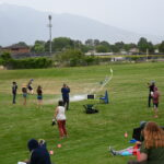 Students watch as homemade rockets are launched