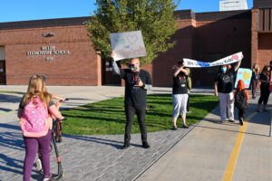 Teachers greeting students at Welby Elementary