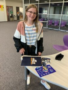 Student shows Utah Jazz Swag she received
