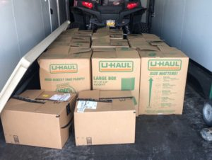 A truck filled with boxes of donations.
