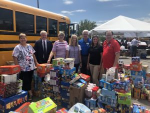 JSD Board members in front of bus with school supplies