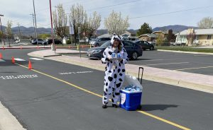 Principal in cow costume