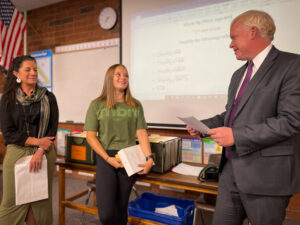 Superintendent Godfrey surprises Anna Fotheringham at West Jordan High School