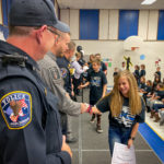 A Terra Lina student shakes officers hands.