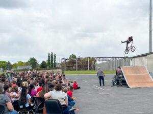BMX Biker performed stunt for students