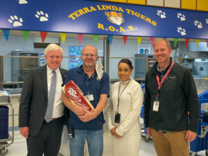 Dr. Godfrey stands with staff from Terra Linda Elementary