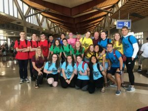 Students and Staff pose for a picture in the airport.