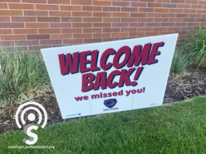 "A ""Welcome Back!"" sign"