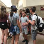 Students talking in a hallway.