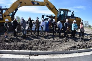 Groundbreaking Ceremony for West Jordan Middle School with dignitaries shoveling dirt
