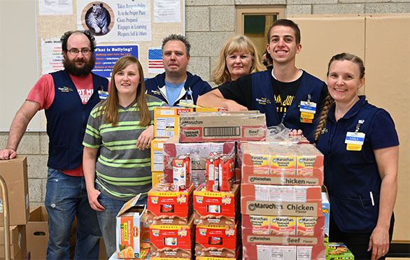 Walmart employees with items donated for students