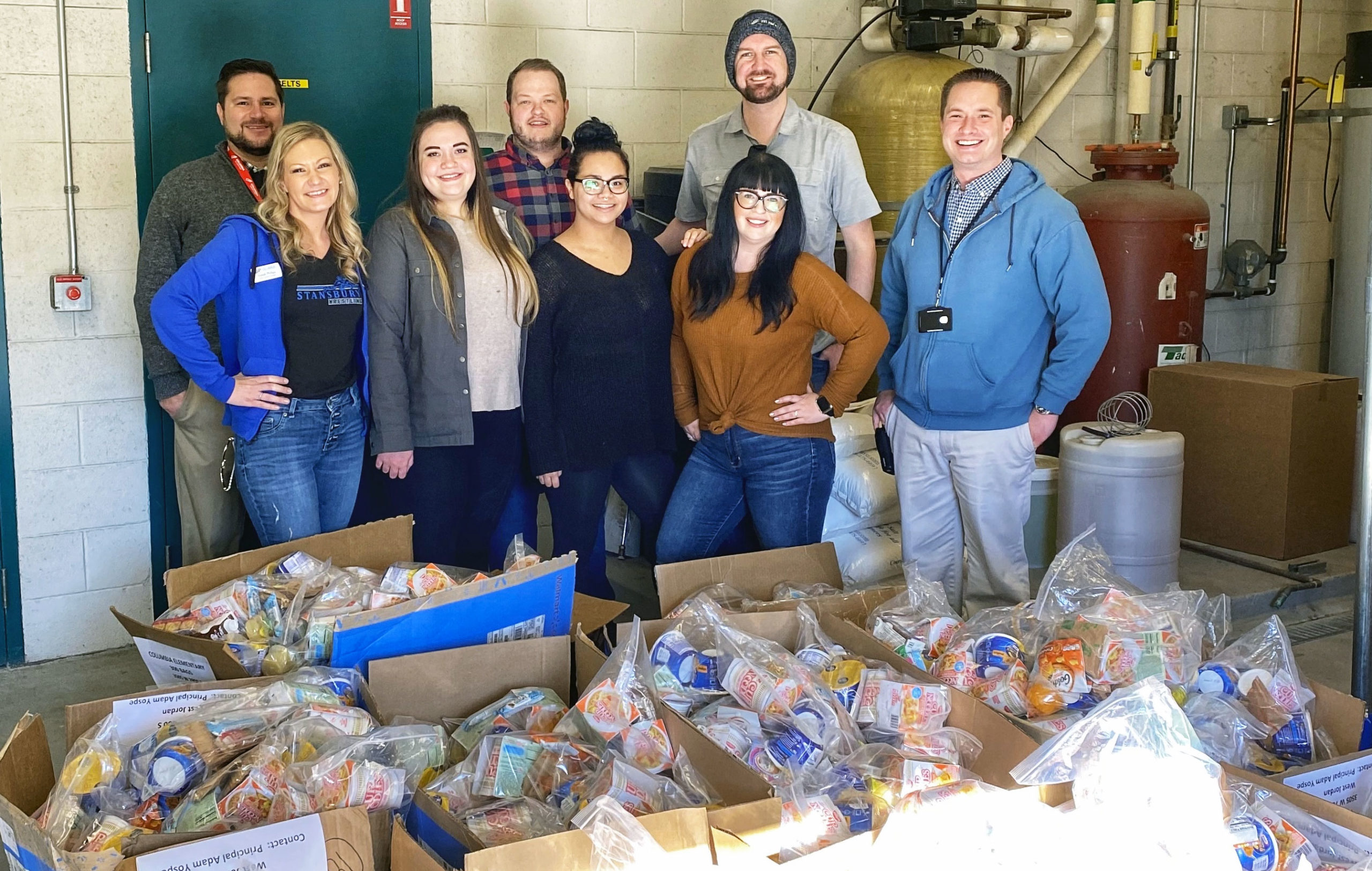 Employees stand with food donation