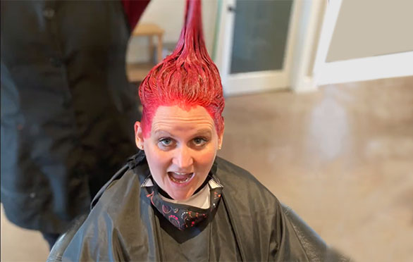 Cherie Wilson is suprised by the appearance of her pink hair
