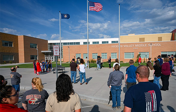 Spectators pay respect to the flag outside Hidden Valley Middle