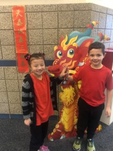 Foothills Elementary Students pose with a paper dragon