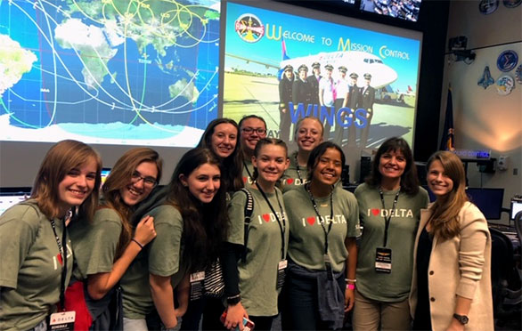 Smiling girls at mission control