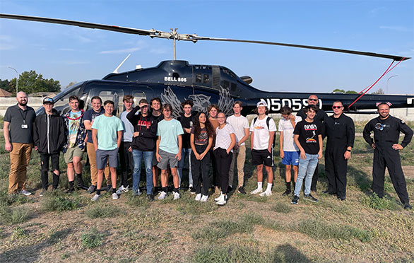 Students stand with the SUU helicopter