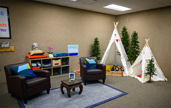 Teepees and chairs in the wellness center